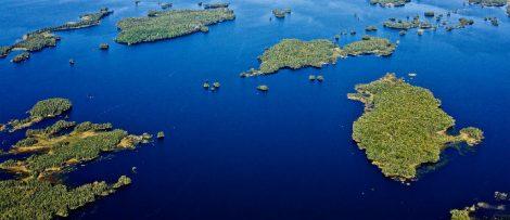 Flygbild över sjön Åsnen. Bildkälla: Miljö- och energidepartementet