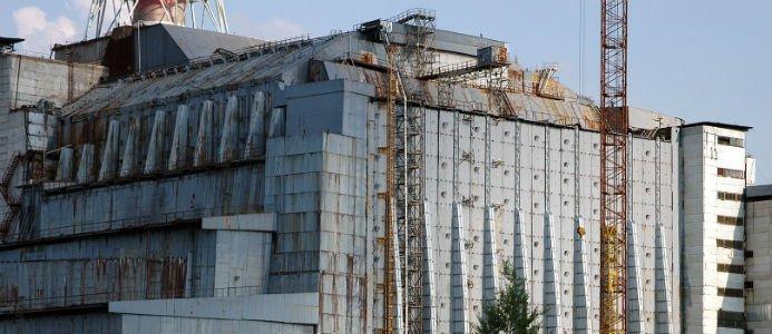 Tjernobyls första sarkofag vid reaktor 4. Photo: Petr Pavlicek/IAEA