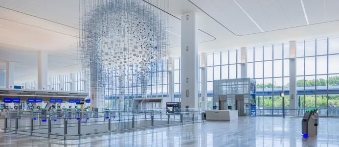 Byggnaden både förändrar reseupplevelsen och effektiviserar driften av flygplatsen.. Bild: Skanska